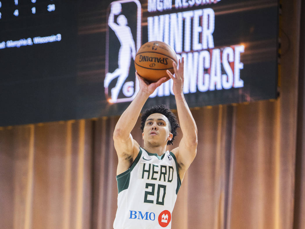 Wisconsin Herd guard Travis Trice (20) shoots a corner three in the second quarter during his G League game with the Memphis Hustle at the Mandalay Bay Convention Center on Thursday, Dec. 20, 2018 ...