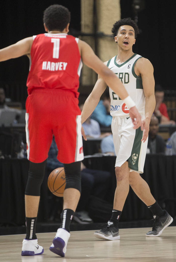 Wisconsin Herd guard Travis Trice (20) directs traffic while being defended by Memphis Hustle guard Tyler Harvey (1) in the second quarter during his G League game at the Mandalay Bay Convention C ...