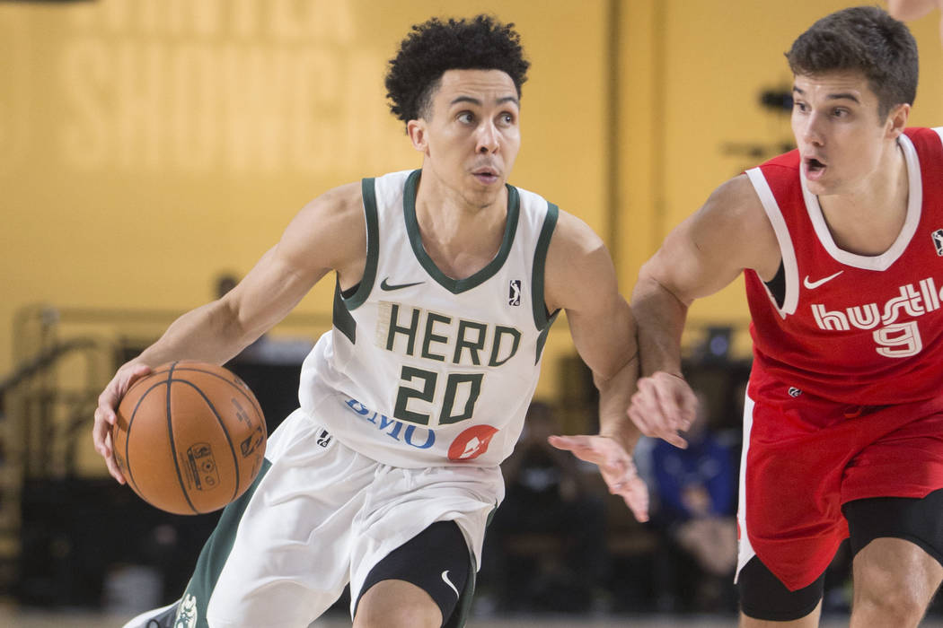 Wisconsin Herd guard Travis Trice (20) drives past Memphis Hustle guard Dusty Hannahs (9) in the fourth quarter during their G League game at the Mandalay Bay Convention Center on Thursday, Dec. ...