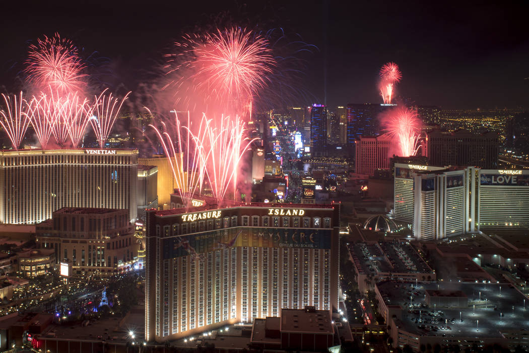 At the stroke of midnight on New Years Eve, fireworks erupt over the Las Vegas Strip in this view looking south from the rooftop of the Trump International Hotel in Las Vegas on Sunday, Jan.1, 201 ...
