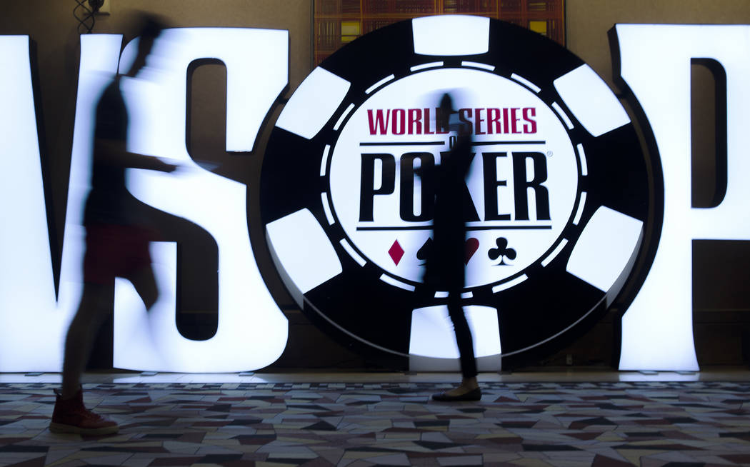People walk past a World Series of Poker sign day five of the competition at the Rio Convention Center in Las Vegas, Monday, July 9, 2018. Rachel Aston Las Vegas Review-Journal @rookie__rae