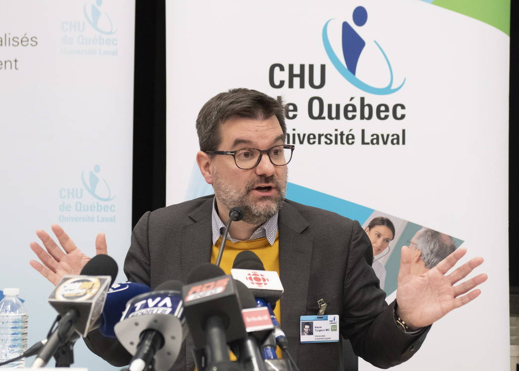 Intensive care specialist Dr. Alexis Turgeon gestures while speaking to reporters about boxer Adonis Stevenson at a hospital in Quebec, Wednesday, Dec. 5, 2018. Stevenson remains in stable but cri ...