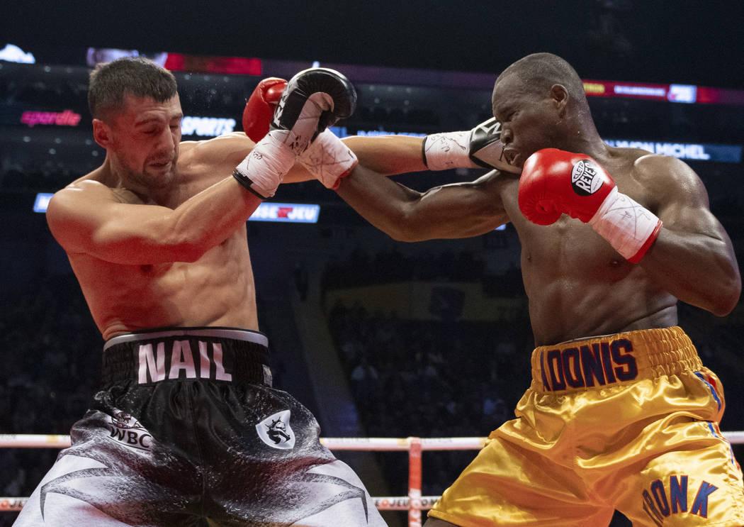 Oleksandr Gvozdyk, left, of Ukraine, lands a right on Adonis Stevenson, of Canada, during their light heavyweight WBC championship boxing fight, Saturday, Dec. 1, 2018 in Quebec City. Gvozdyk won ...