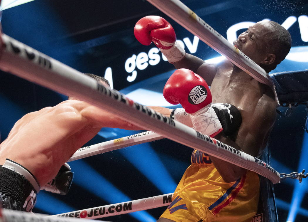 Oleksandr Gvozdyk, of Ukraine, lands a knockout punch to Adonis Stevenson, of Canada, to win the WBC light heavyweight championship boxing bout Saturday, Dec. 1, 2018, in Quebec City. (Jacques Boi ...