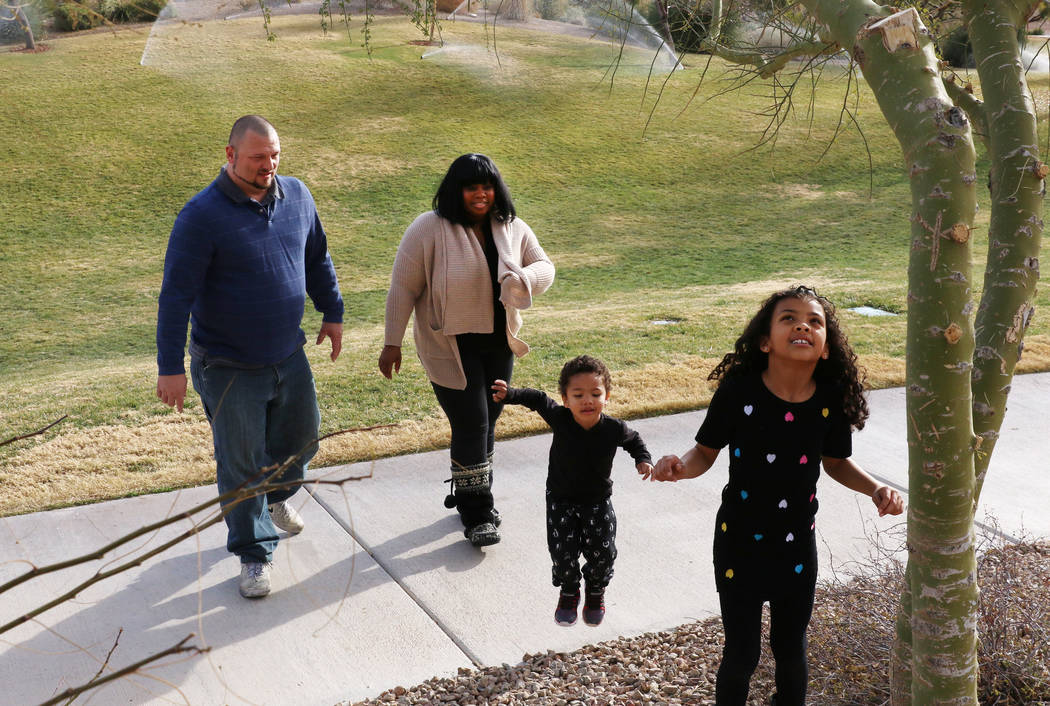 Kevin Pauley and his wife Erica play with their kids Charlie, 2, and Meena, 7, at Exploration Peak Park on Monday, Dec. 24, 2018, in Las Vegas. Bizuayehu Tesfaye Las Vegas Review-Journal @bizutesfaye