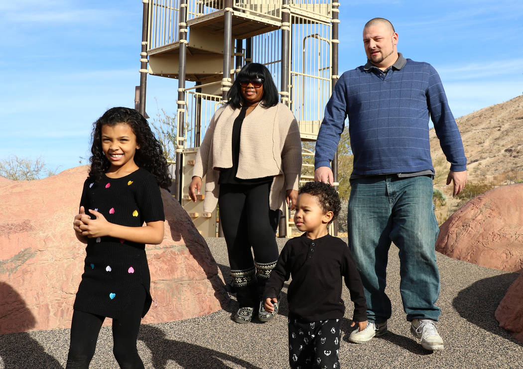 Erica Kyles-Pauley and her husband Kevin play with their kids Charlie, 2, and Meena, 7, at Exploration Peak Park on Monday, Dec. 24, 2018, in Las Vegas. Bizuayehu Tesfaye Las Vegas Review-Journal ...