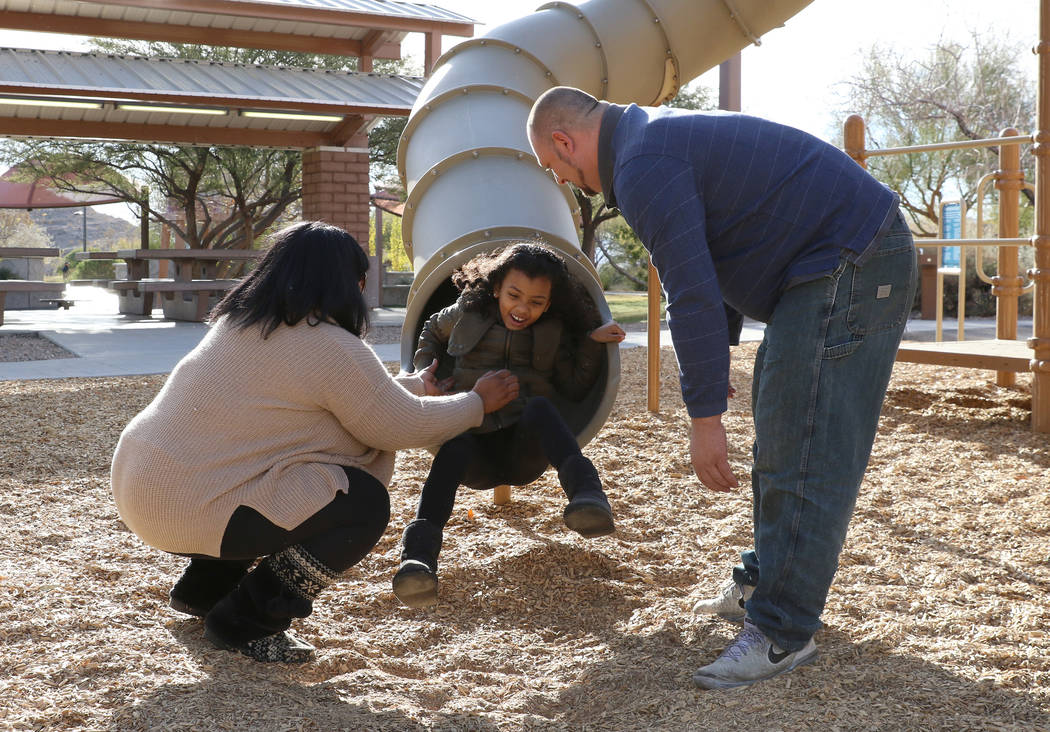 Kevin Pauley and his wife Erica play with their daughter Meena, 7, at Exploration Peak Park on Monday, Dec. 24, 2018, in Las Vegas. Bizuayehu Tesfaye Las Vegas Review-Journal @bizutesfaye