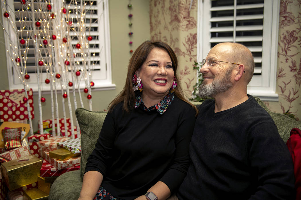 Wife and Husband Christie Faux, 63, left, and Kurt Faux, 61, sit together on a couch in their home in Henderson, Saturday, Dec. 22, 2018. Caroline Brehman/Las Vegas Review-Journal