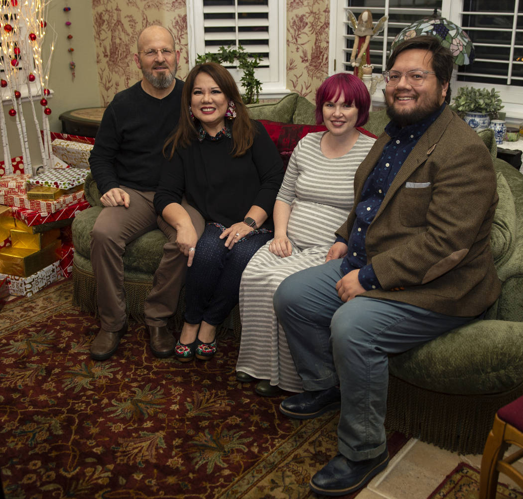 Husband and wife Kurt Faux, 61, left, and Christie Faux, 63, sit with their daughter-in-law Rose Card-Faux, 35, and son Jordan Faux, 36, in their home in Henderson, Saturday, Dec. 22, 2018. Caroli ...