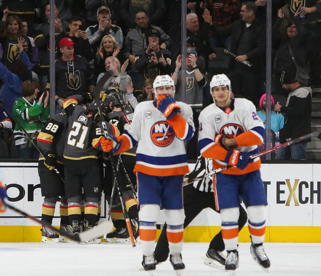 Vegas Golden Knights celebrate after their center Brandon Pirri (73) scoring a goal against the New York Islanders during the second period of an NHL hockey game at T-Mobile Arena in Las Vegas, Th ...