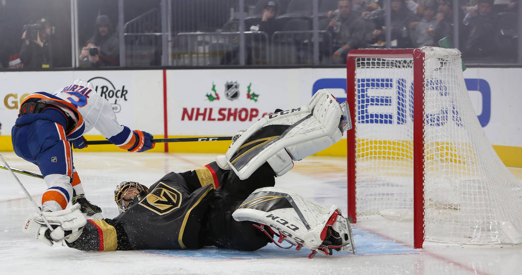 Vegas Golden Knights goaltender Marc-Andre Fleury (29) blocks a shot from New York Islanders center Mathew Barzal during the third period of an NHL hockey game at T-Mobile Arena in Las Vegas, Thur ...