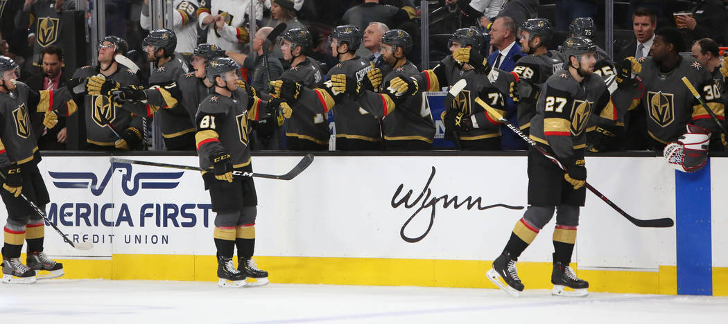 The Vegas Golden Knights give each other high fives after Vegas Golden Knights center Paul Stastny (26) scores against the New York Islanders during the third period of an NHL hockey game at T-Mob ...