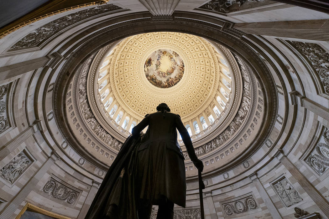 The statue of George Washington is seen beneath the Rotunda in the Capitol in Washington, Thursday, Dec. 20, 2018. (AP Photo/J. Scott Applewhite)
