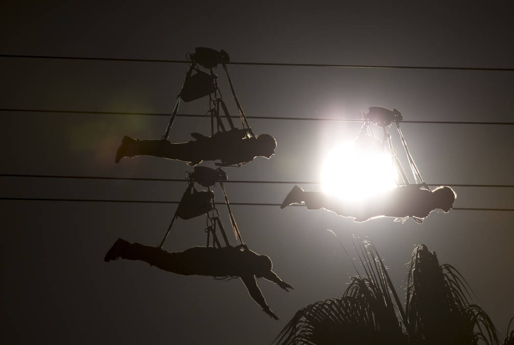 Thrill-seekers ride the SlotZilla Zip Line at the Fremont Street Experience during the winter solstice in downtown Las Vegas on Friday, Dec. 21, 2018. The winter solstice marks the day with the sh ...
