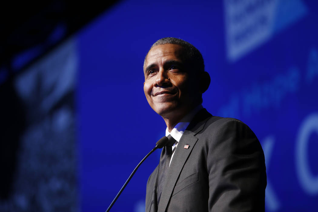 =In this Dec. 12, 2018 file photo, former President Barack Obama accepts the Robert F. Kennedy Human Rights Ripple of Hope Award at a ceremony in New York. (AP Photo/Jason DeCrow, File)