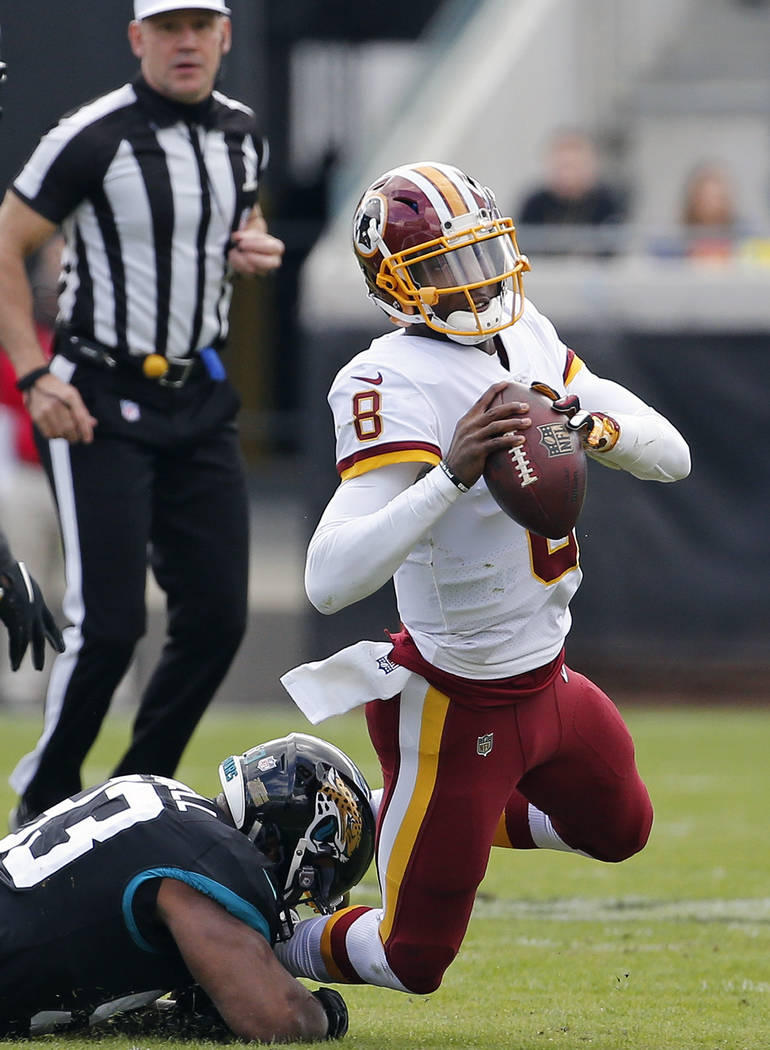 Washington Redskins quarterback Josh Johnson (8) is sacked by Jacksonville Jaguars defensive end Calais Campbell, left, during the first half of an NFL football game, Sunday, Dec. 16, 2018, in Jac ...