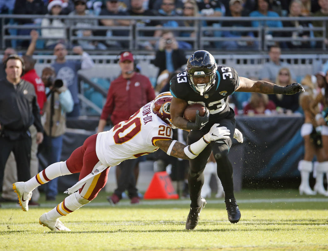 Washington Redskins strong safety Ha Ha Clinton-Dix (20) stops Jacksonville Jaguars running back David Williams (33) after a short gain during the second half of an NFL football game, Sunday, Dec. ...