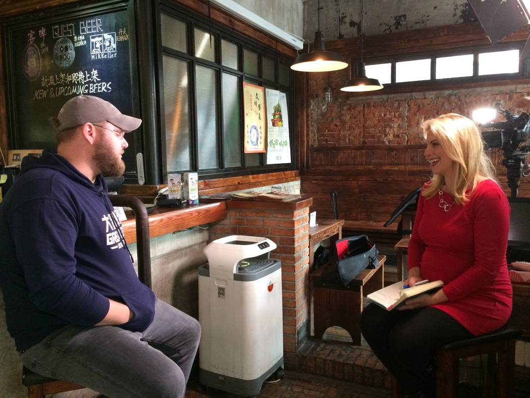 Jessica Stone, a White House Correspondent with CGTN America, interviews a Beijing brewer about Entrepreneurship in China. (Jessica Stone)
