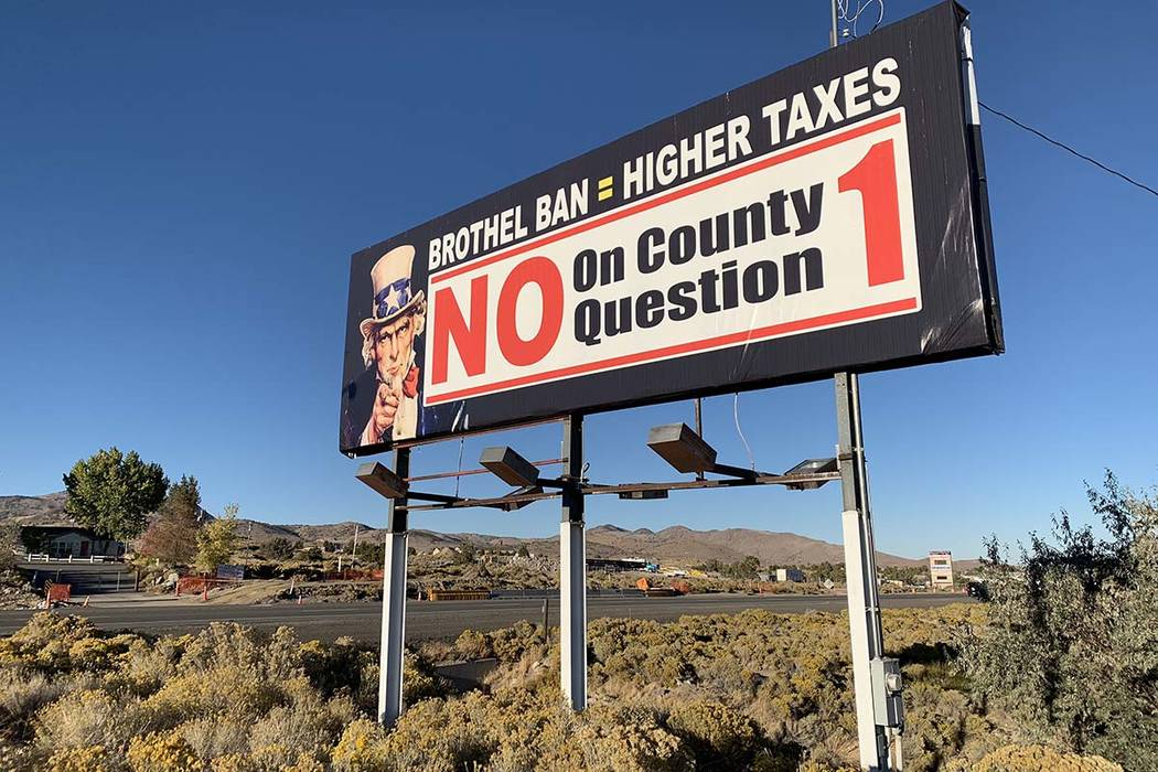 A sign outside the Bunny Ranch restaurant in Mound House, Lyon County, urges passersby to vote against banning legal prostitution in the county. (Bill Dentzer/Las Vegas Review-Journal)