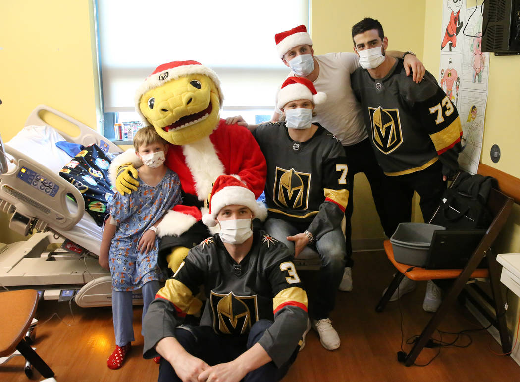 Jacob Bailey, 7, left, poses for a photo with Golden Knights players Brayden McNabb (3) William Karlsson, center, Nate Schmidt, second right, Brandon Pirri, right, and Golden Knights mascot Chance ...