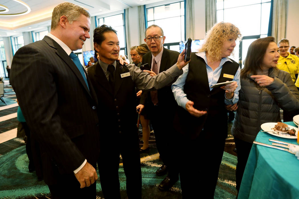 MGM CEO Jim Murren, left, poses for selfies at the MGM Grand Conference Center in Las Vegas, Friday, Dec. 22, 2018, with MGM Grand employees that have worked at the property since its opening 25 y ...