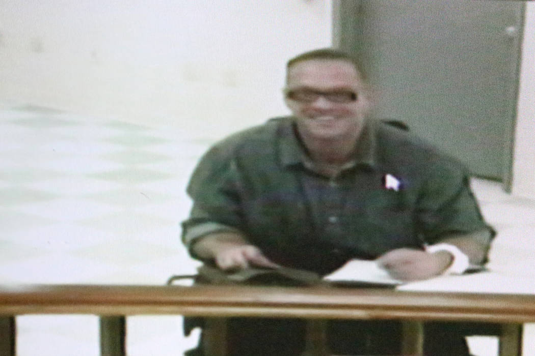 Scott Dozier, a convicted murderer who wants to be executed, appears in court via video conference on Wednesday, Nov. 8, 2017, four business days before his scheduled execution. Michael Quine/Las ...