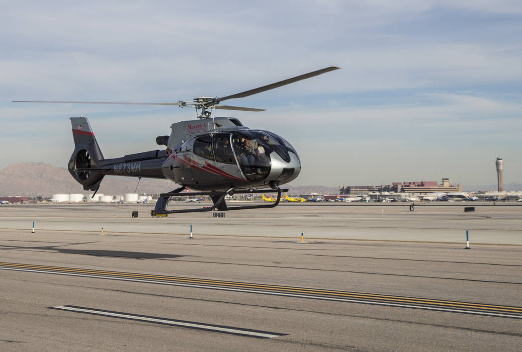 A Maverick tour helicopter lands with McCarran International Airport in the background on Tuesday, Dec. 18, 2018, at Maverick Helicopters, in Las Vegas. Benjamin Hager Las Vegas Review-Journal