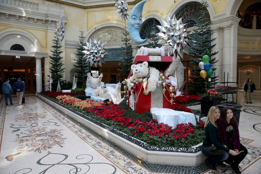 Julie Nideffer and her daughter Stella Vazquez, 8, of Houston at Majestic Holiday Magic at the Bellagio Conservatory & Botanical Gardens in Las Vegas Friday, Dec. 21, 2018. The display will be ...