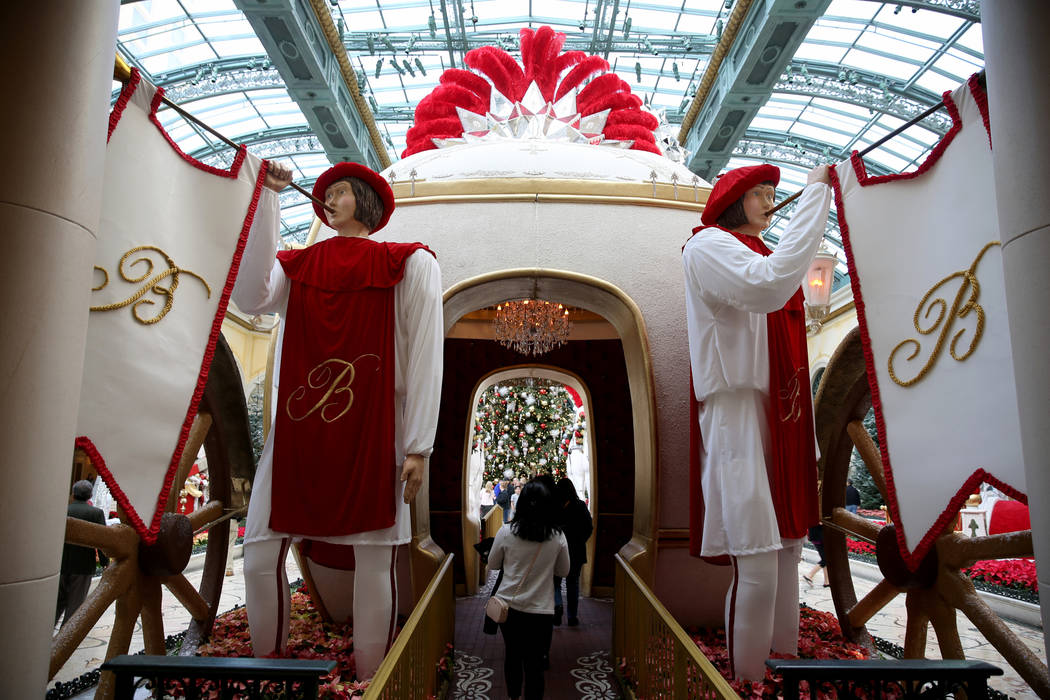 Guests check out the Majestic Holiday Magic at the Bellagio Conservatory & Botanical Gardens in Las Vegas Friday, Dec. 21, 2018. The display will be up through Jan. 6, 2019. K.M. Cannon Las Ve ...