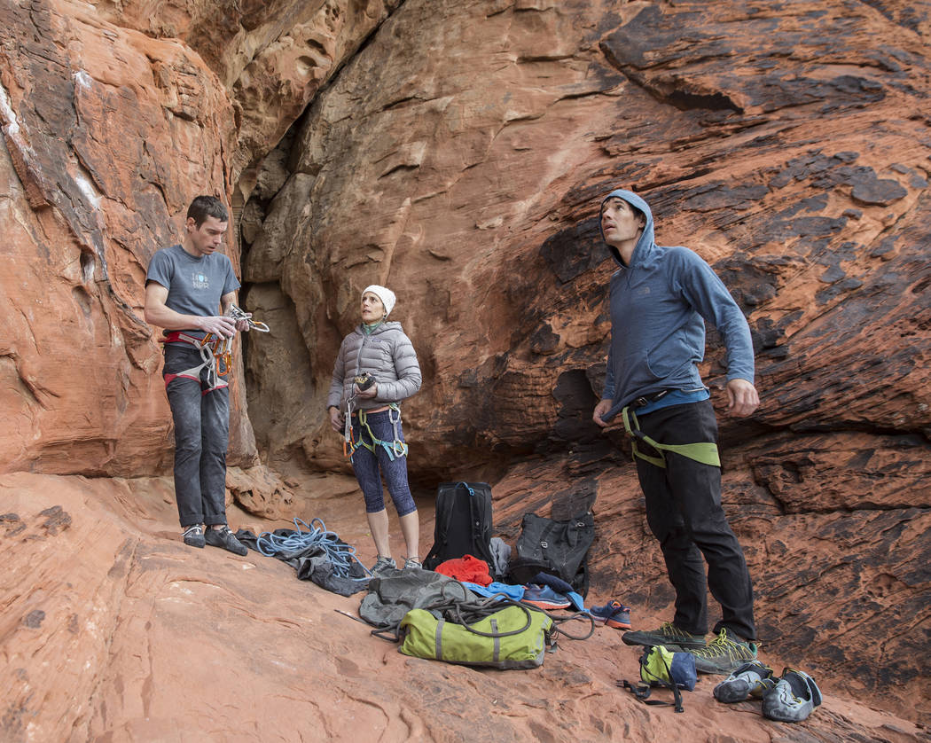 Alex Honnold, right, Maria Bortot and Allen Bishop prepare to climb at The Gallery at Red Rock Canyon on Monday, Dec. 17, 2018, in Las Vegas. Honnold, arguably the best rock climber in the world, ...