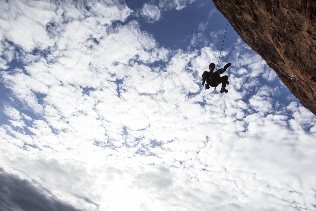 Alex Honnold descends The Gallery at Red Rock Canyon on Monday, Dec. 17, 2018, in Las Vegas. Honnold, arguably the best rock climber in the world, solo climbed El Capitan, a 3,000-foot granite wal ...