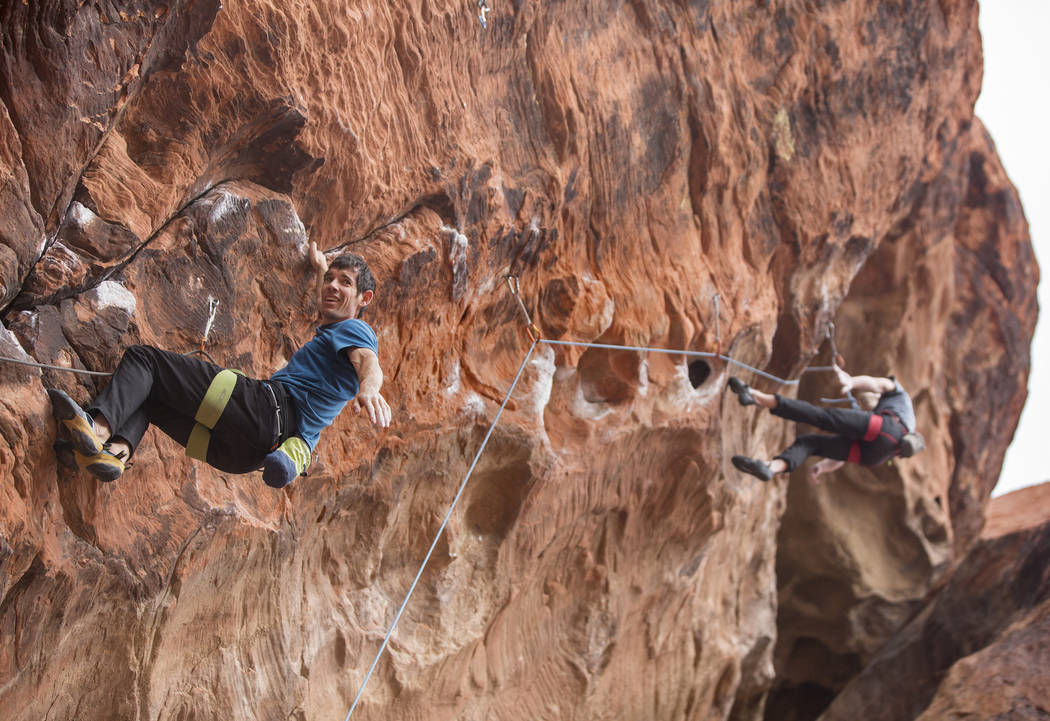 Alex Honnold, left, ascends The Gallery at Red Rock Canyon on Monday, Dec. 17, 2018, in Las Vegas. Honnold, arguably the best rock climber in the world, solo climbed El Capitan, a 3,000-foot grani ...