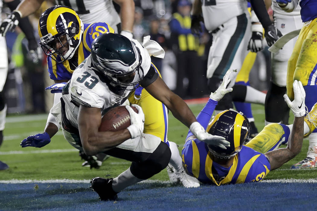 Philadelphia Eagles running back Josh Adams scores past Los Angeles Rams free safety Lamarcus Joyner during the first half in an NFL football game Sunday, Dec. 16, 2018, in Los Angeles. (AP Photo/ ...