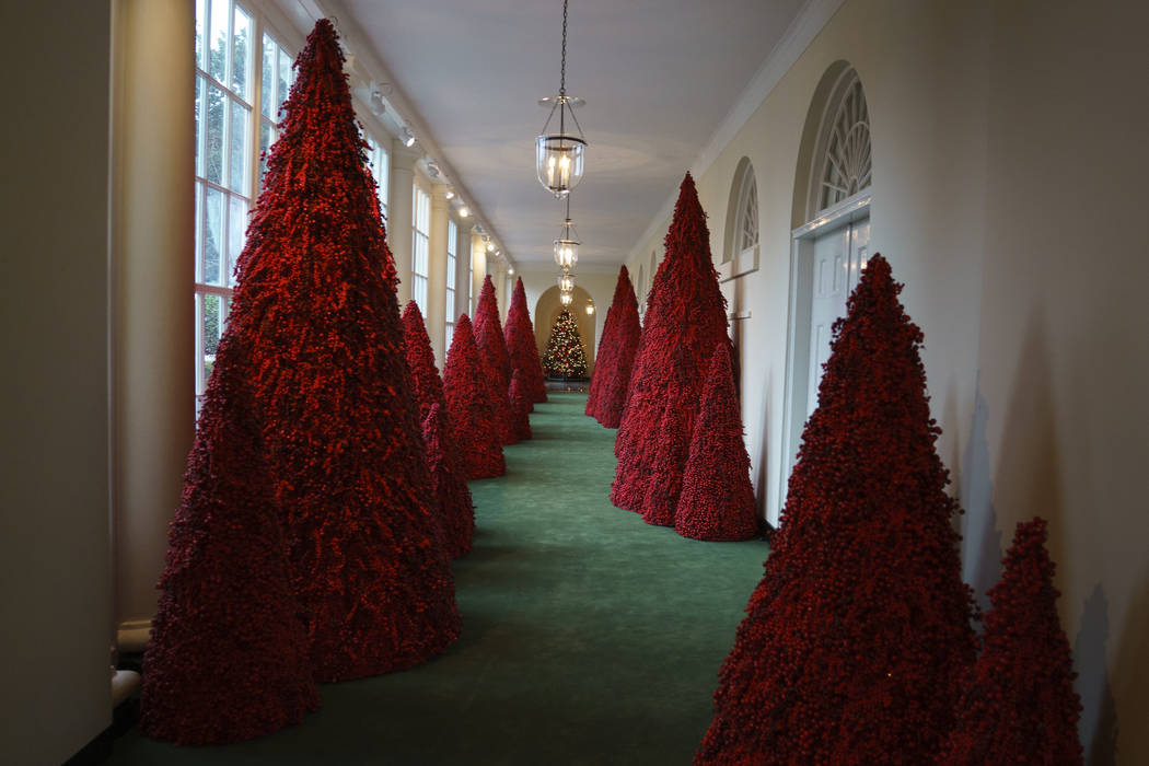 Topiary trees line the East colonnade during the 2018 Christmas Press Preview at the White House in Washington, Monday, Nov. 26, 2018. (AP Photo/Carolyn Kaster)