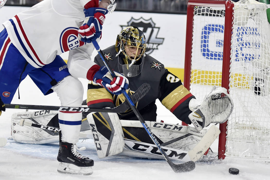 Montreal Canadiens left wing Paul Byron (41) shoots against Vegas Golden Knights goaltender Marc-Andre Fleury during the third period of an NHL hockey game Saturday, Feb. 17, 2018, in Las Vegas. ( ...