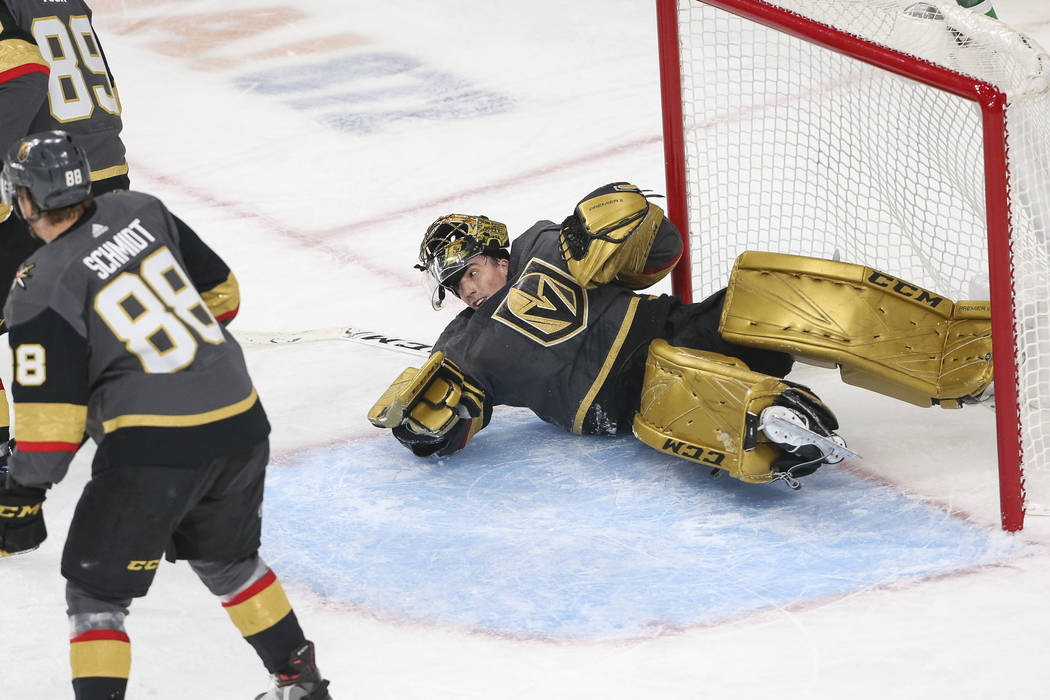 Vegas Golden Knights goaltender Marc-Andre Fleury (29) loses his helmet as he scrambles to get up after making a save during the first period of an NHL hockey game against the Montreal Canadiens a ...