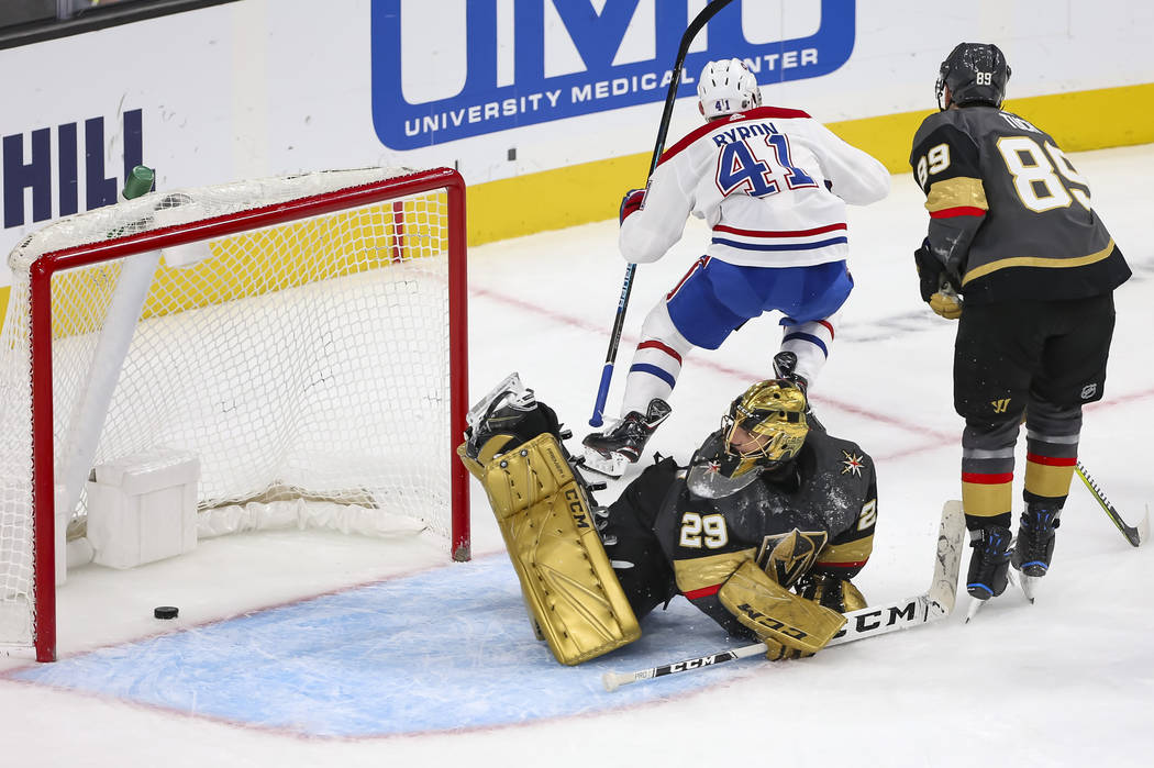 Vegas Golden Knights goaltender Marc-Andre Fleury (29) looks back at his net after Montreal Canadiens left wing Paul Byron (41) scored the game-winning goal in overtime during an NHL hockey game a ...