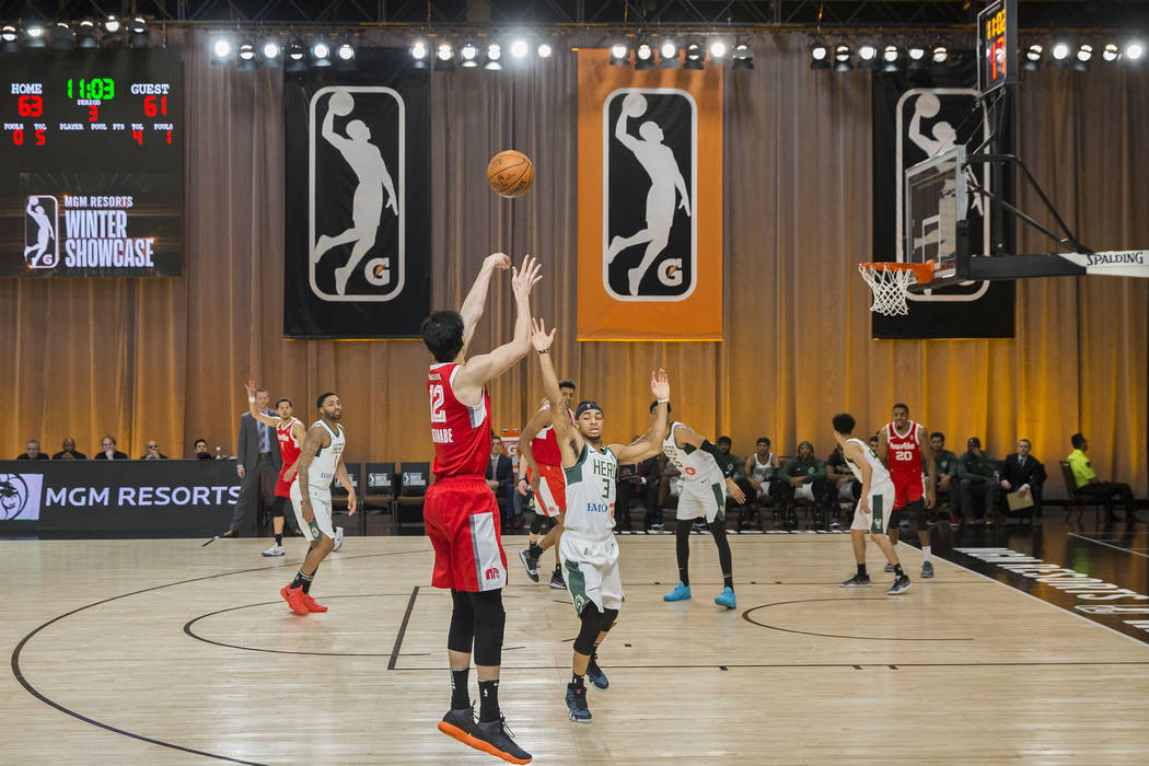Memphis Hustle forward Yuta Watanabe (12) shoots a three point shot over Wisconsin Herd guard Jaylen Morris (3) in the third quarter during their G League game at the Mandalay Bay Convention Cente ...