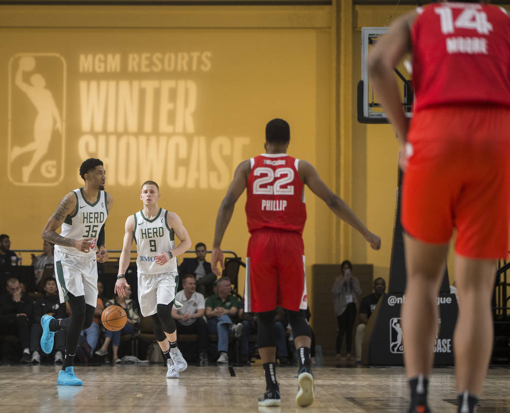Wisconsin Herd forward Donte DiVincenzo (9) pushes the ball up court in the fourth quarter against the Memphis Hustle during their G League game at the Mandalay Bay Convention Center on Thursday, ...