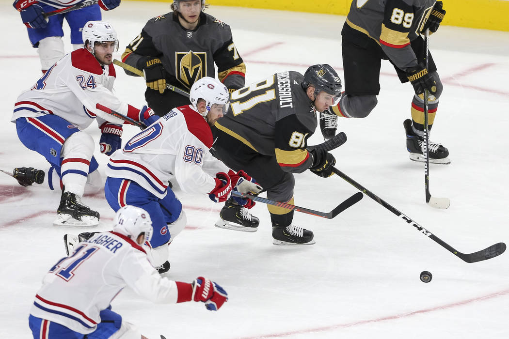 Vegas Golden Knights center Jonathan Marchessault (81) and Montreal Canadiens left wing Tomas Tatar (90) chase the puck during the first period of an NHL hockey game at T-Mobile Arena in Las Vegas ...