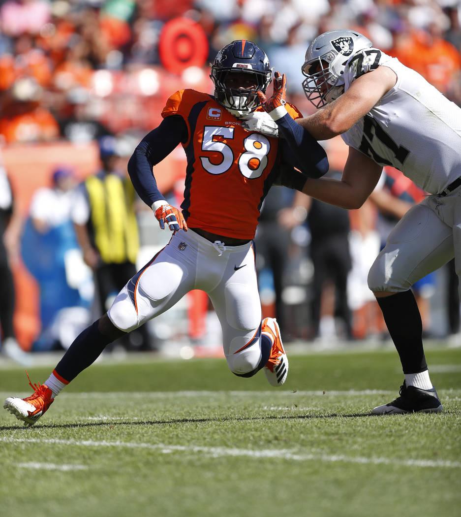 Oakland Raiders offensive tackle Kolton Miller (77) blocks against Denver Broncos linebacker Von Miller (58) during the first half of an NFL football game, Sunday, Sept. 16, 2018, in Denver. (AP P ...