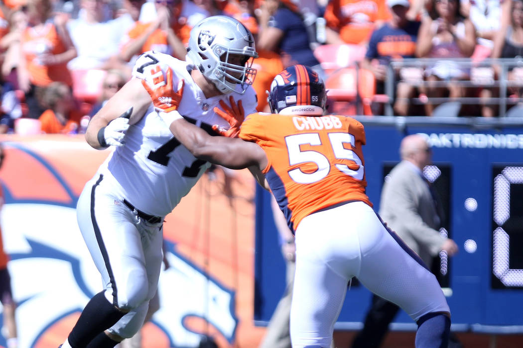 Oakland Raiders offensive tackle Kolton Miller (77) holds off Denver Broncos linebacker Bradley Chubb (55) during the first half of an NFL game in Denver, Colo., Sunday, Sept. 16, 2018. Heidi Fang ...