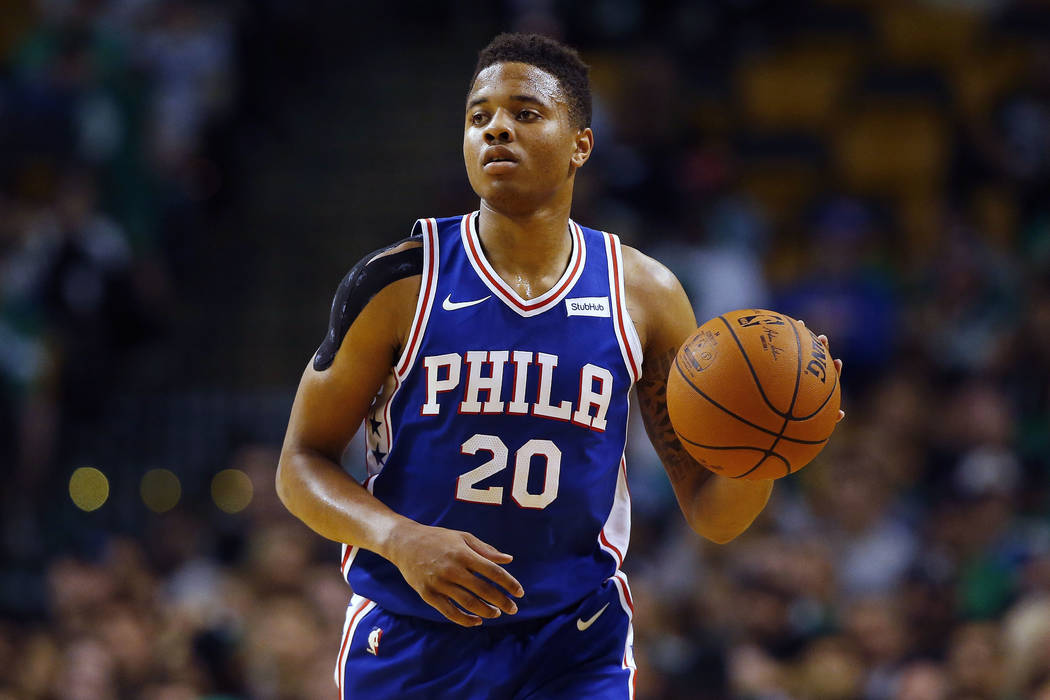 In this Oct. 9, 2017, photo, Philadelphia 76ers guard Markelle Fultz controls the ball during the first quarter of a preseason NBA basketball game against the Boston Celtics in Boston. (AP Photo/W ...