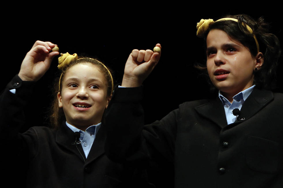 Children from Madrid's San Ildefonso school call out the winning lottery ticket number 03347 at Madrid's Teatro Real opera house during Spanish Christmas Lottery draw in Madrid, Spain, Saturday, D ...