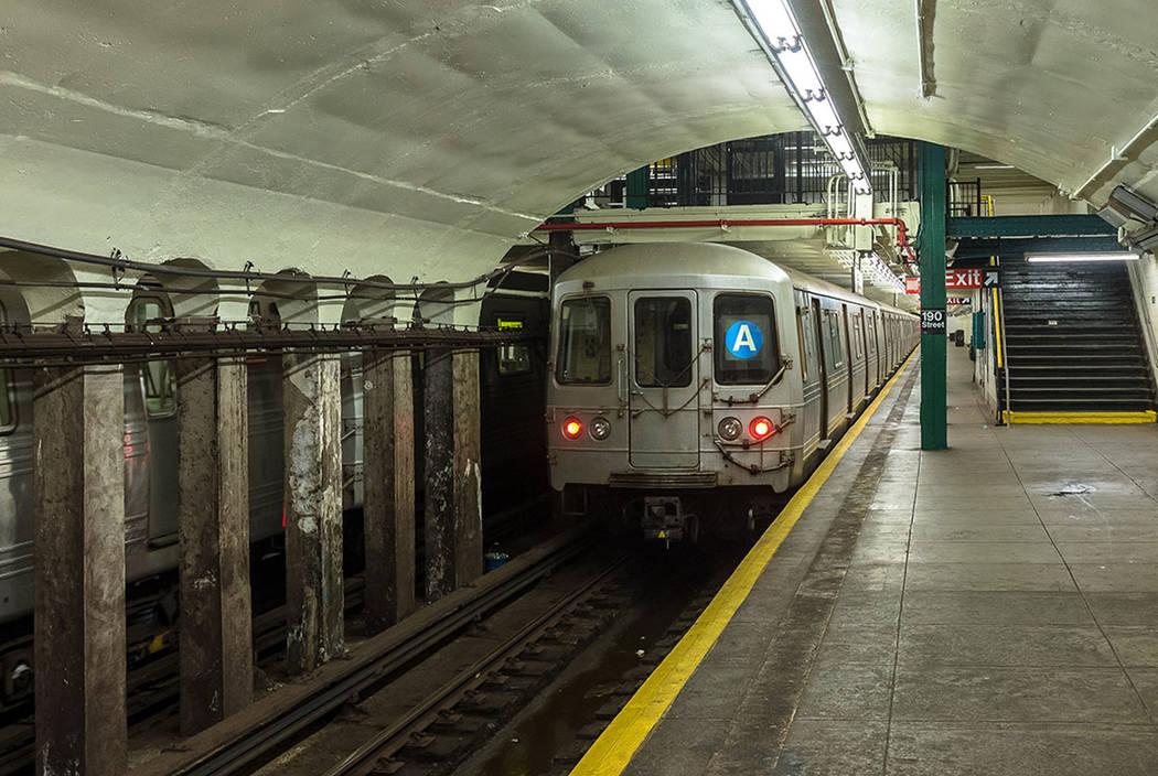Subway station and running train in New York City (Thinkstock)