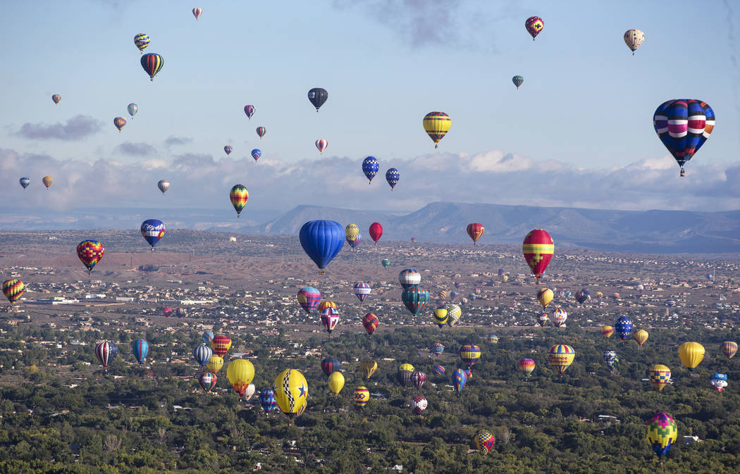 Hot air balloons take part in a flying competition during the 47th annual Albuquerque International Balloon Fiesta in Albuquerque, New Mexico on Monday, Oct. 8, 2018. (Richard Brian Las Vegas Revi ...