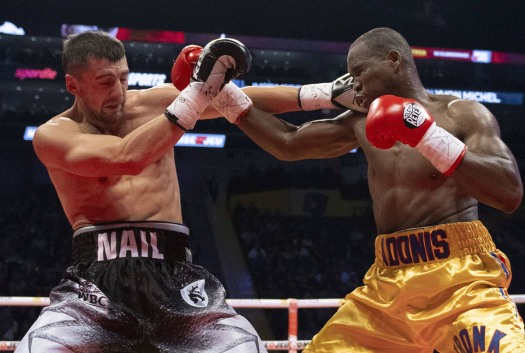 Oleksandr Gvozdyk, left, of Ukraine, lands a right on Adonis Stevenson, of Canada, during their light heavyweight WBC championship boxing fight, Saturday, Dec. 1, 2018 in Quebec City. Gvozdyk won ...