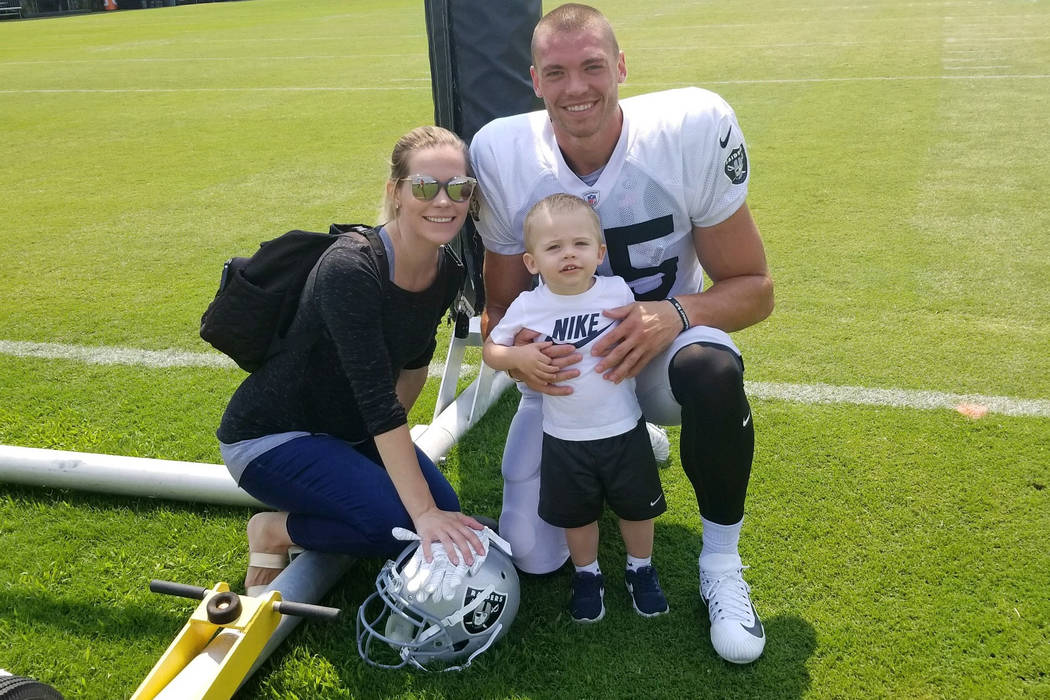 Raiders tight end Derek Carrier and wife Dora Carrier pose with son Dominic at the team's Napa Valley Marriott training camp headquarters in August of 2018 in Napa, Calif. (Courtesy: Carrier family)
