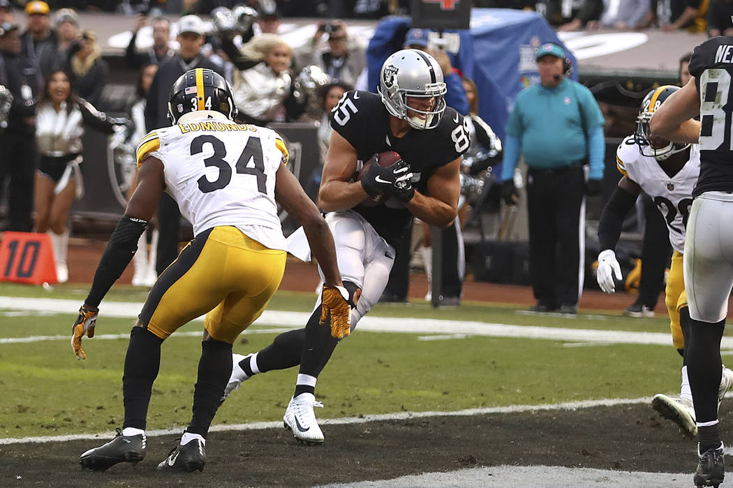 Oakland Raiders tight end Derek Carrier (85) scores against the Pittsburgh Steelers during the second half of an NFL football game in Oakland, Calif., Sunday, Dec. 9, 2018. (AP Photo/Ben Margot)