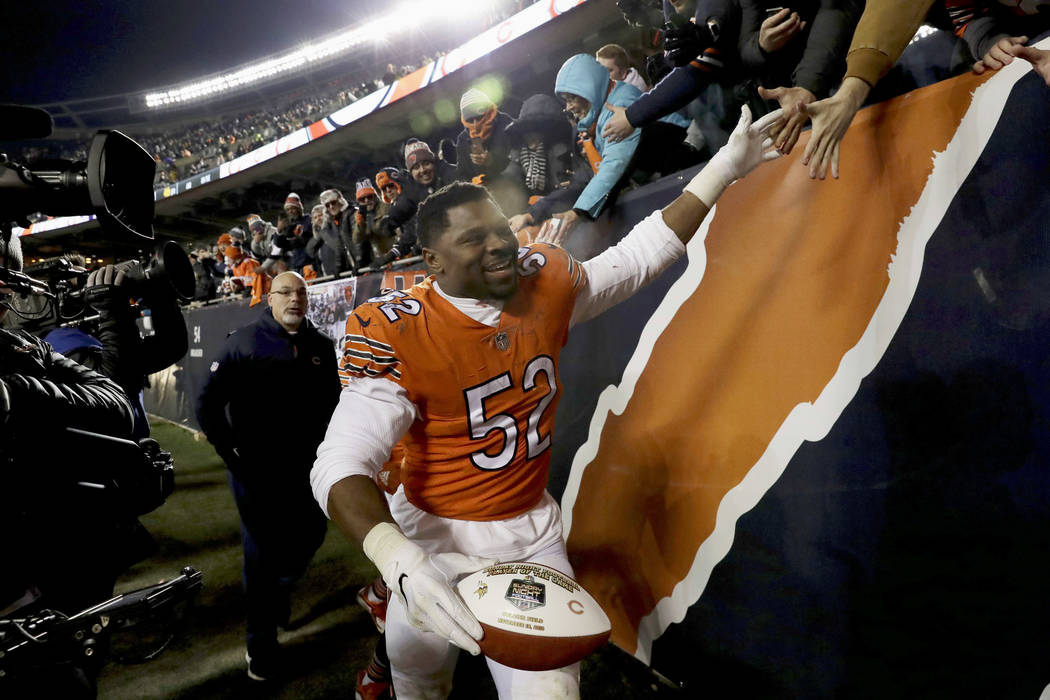 Chicago Bears outside linebacker Khalil Mack (52) celebrates with fans after an NFL football game against the Minnesota Vikings Sunday, Nov. 18, 2018, in Chicago. The Bears won 25-20. (AP Photo/Na ...